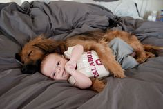 THATS CUTE AND ALL, BUT THERE IS NO WAY IN THE WORLD I COULD LET A DOG CUDDLE UP WITH MY BABY!