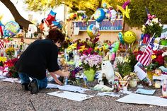 An impromptu shrine of flowers, balloons, posters and stuffed animals grew outside Ms. Giffords's Tucson office. Brandon Sullivan for The Wall Street Journal