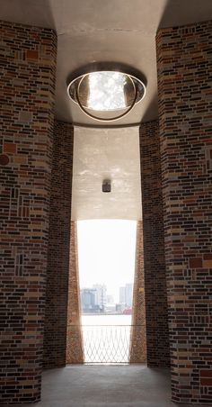 in vejle, denmark, olafur eliasson and his studio has completed its first architectural building project, fjordenhus, commissioned by KIRK KAPITAL. Vejle, Brick Architecture, Architecture Details, Studio Olafur Eliasson, Round Building, Glazed Brick, Public Space Design, Stone Street, Glass Structure