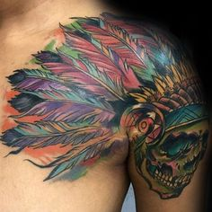 Colorful illustrative style shoulder tattoo skull with helmet made from feather