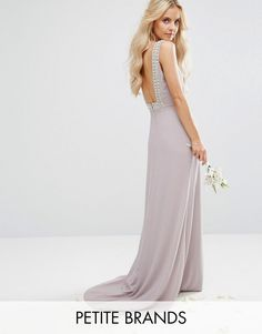 Get this TFNC Petite's cocktail dress now! Click for more details. Worldwide shipping. TFNC Petite Wedding High Neck Maxi Dress With Embellished Low Back - Grey: Petite dress by TFNC, Lined woven fabric, High neck, Faux-pearl embellishment, Low-cut back, Zip-back fastening, Slim fit - cut close to the body, Hand wash, 100% Polyester, Our model wears a UK 8/EU 36/US 4 and is 163cm/5'4 tall. London label TFNC is renowned for its standout occasionwear. Step it up in sparkly fabrics, embellished…