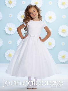 Joan Calabrese for Mon Cheri - 116397 - Satin and organza tea-length A-line dress with gathered short sleeves, slight scooped neckline, lace natural waist include removable satin band with small center bow, full gathered organza overlay skirt.Sizes: 2 – 14Colors: White, Ivory