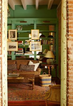 Back bookshelves with mirror to reflect light (especially delicious in an old French Quarter home!) | Rebirth in New Orleans - October 2014 - Lonny