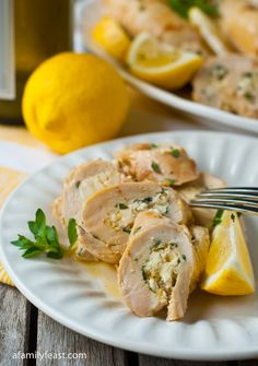 Greek Chicken Roulade - a wonderful light dish of chicken stuffed with feta cheese, oregano, lemon zest and garlic and wonderful white wine pan sauce. Simple enough for everyday but fancy enough for a summer dinner party!