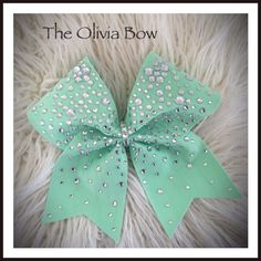 The Olivia Cheer Bow Mint green spandex embellished with crystal rhinestones BLING by TalkToTheBow on Etsy https://www.etsy.com/listing/227314721/the-olivia-cheer-bow-mint-green-spandex