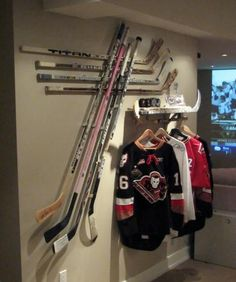 c751f6503 Neat display for all those old sticks. Shelf is a super idea for all the.  Hockey ...
