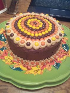 Thanksgiving 2015.  Cake made for break room where my works.  Chocolate cake filled with chocolate buttercream. Iced on sides with homemade chocolate buttercream.  Trim is peanut butter cream.  Decorated with Reese's Pieces.