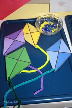Color sorting and fine motor activity with kites and beads