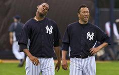 New York Yankees pitchers Ivan Nova and Hiroki Kuroda (R) cool down after running sprints