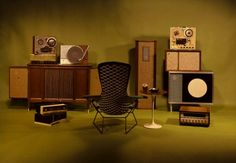 Retro 1960s Hi Fi stereo equipment and mid century modern furniture-- great old Tulip table.