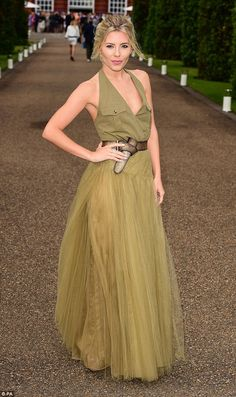 Show stopper: Mollie King stunned in a plunging khaki gown as she attended a pre-Wimbledon...