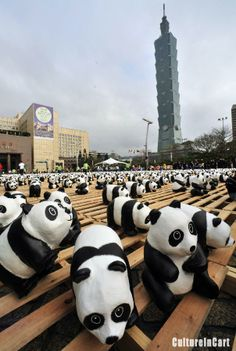 """An open-air exhibition titled """"Pandas World Tour - Taipei"""" at the Citizens' Square in Taipei, southeast China's Taiwan, Feb. 27, 2014. A total of 1,600 pandas and Formosan black bears made of environmentally-friendly paper material went on show here on Thursday. The event aims at promoting environmental protection and raising the public's awareness of animal preservation. All of the paper pandas and black bears on display will be open for charity sale after the event concludes on March 30."""