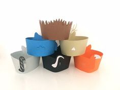"""Included in this listing is 12 x Woodlands Cupcake Wrapper/Holders of your choice of colour. All pieces are handmade and ready to place around your cupcake.  I have 6 different characters (Skunk, Raccoon, Owl, Deer, Fox and Hedgehog). You have the choice of which animals you would like. Please leave a message in the """"note to Seller Box' with your choice.  Our Cupcake Wrappers are made from Premium Double Sided Cardstock in multiple layers (Not A Printed Image). Our Cupcake wrappers are the…"""