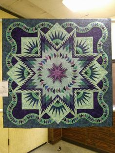 Glacier Star designed by Quiltworx.com, made by Audrey Campbell, and quilted by Marlene Oddie of KISSed Quilts.  Received Best of Show, Walla Walla Fair and Frontier Days 2013.