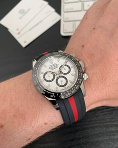 Our red & black bi-color Curved End Rubber Strap is a perfect fit for the sporty Rolex Daytona. What do you think? 👀 . To get this look, head to our website www.everestbands.com (link in bio)