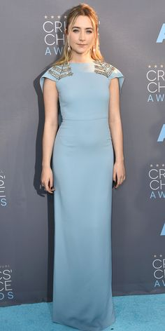 SAOIRSE RONAN opts for a sky-blue gown with beaded chevron details at the shoulders, and pale pink geometric drop earrings.