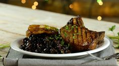 Recipe with video instructions: Paired with seasoned black beans, this sweet and savory pork dish is packed with flavor. Ingredients: 4 thick pork chops, Salt & pepper, ½ cup brown sugar, ¼ cup of soy sauce, 1 can pineapple rings in juice (keep the juice), 1 Tbsp onion powder, 1 Tbsp garlic powder, 1 tsp ground ginger, 1 can black beans, 1 cup crushed tomatoes, 1 tsp oregano, 1 tsp cumin