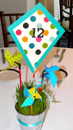Kite/Pin Wheel/ Wheat Grass center pieces - Annual gala for Our Lady of Mercy Catholic School.