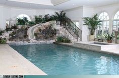 Indoor pool with water slide. A must have in Oregon. Love the arched windows in the background.