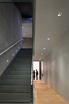 Completed in 2009 in Vancouver, Canada. Images by Nic Lehoux. The new Rennie Art Gallery and Office project is a quiet, modern insertion within an extensive heritage revitalization of a pair of masonry buildings. Museum Lighting, Vancouver, Steel Stairs, Loft Studio, Stair Steps, Entry Hallway, Minimalist Interior, Interior Architecture, Building Architecture