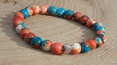 Náramek z mořských nefritových korálků a srdíčkem Kuličky z mořského nefritu (nebo-li Jadeitu) mají krásnou modrooranžovou barvu. Na náramku nenajdete dva stejné korálky, každý je originál. 27 korálků je doplněno o 1 srdíčko. Celkově náramek působí jemně (korálky jsou veliké 6 mm) a díky barvám jako teplý podzim.  Délka náramku cca 17-18 cm, navlečeno na elastickém lanku. Beaded Bracelets, Jewelry, Fashion, Moda, Jewlery, Jewerly, Fashion Styles, Pearl Bracelets, Schmuck