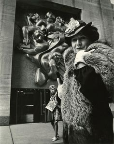 """Bill Cunningham, the shutterbug whose stunning street style photography has become a mainstay in the fashion world, has always had an eye for all things in vogue. A new exhibit at the New York Historical Society features 88 silver gelatin prints from Cunningham's """"Facades"""" photo essay, a project he undertook between 1968 and 1978 that matches models in period costumes with iconic New York buildings from the same era. Here, Cunningham's muse Editta Sherman stands in front of Rockefeller…"""