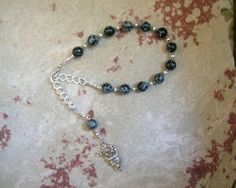 Hades Prayer Bead Bracelet in Snowflake Obsidian: Greek God of Death and the Afterlife, Abundance and Wealth, and King of the Underworld by HearthfireHandworks on Etsy