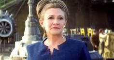 General Leia Organa in the long blue dress with cut-out neckline and boots