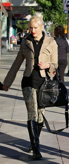 Bun, lipstick, khaki jacket, black top, khakis, black boots.