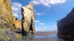 Exploring the Sea Caves of Three Sisters Beach in the Taranaki Region, N...