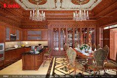 Thiết kế phòng bếp ăn nội thất Pháp với những đường nét hoa văn gỗ tinh xảo đẹp mắt, trang trí 2 chiếc đèn chùm làm tăng thêm vẻ đẹp quyến rũ cho không gian bếp ăn lung linh