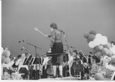 Julia using a large wooden spoon to conduct the Boston Pops on Cape Cod  - Submitted by Nancy Barr