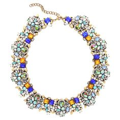 Bold and brilliant, this striking beaded necklace defines your evening ensembles with stunning crystals and colorful stones.