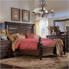 Panel bed...rich woods with carved details