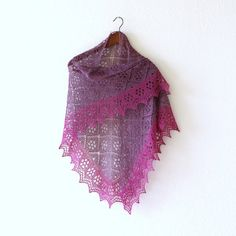 This hand knit shawl is made with a blend of merino wool and silk. It is very…
