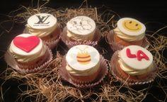 Cupcakes variadas con frosting, fondant y papel de azúcar