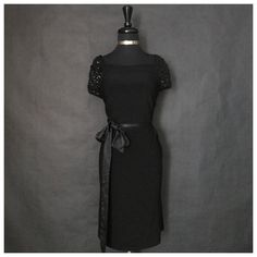 "This is a stunning Bisou Bisou brand formal black dress. The dress is all black, has sequin shoulders, a bow knot waist and perfect for a formal evening out. The dress is made of 95% polyester and 5% spandex. It is a plus size 24W with the following measurements:    Length: 41""    Bust Range: 46"" - 55""    Waist Range: 46"" - 58""    This item ships immediately to US addresses. 📦 Also available for local try on and pick up in Sacramento, CA. ✨ 