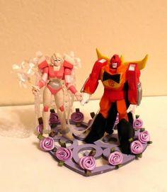 Hot Rod and Arcee Wedding Cake Topper