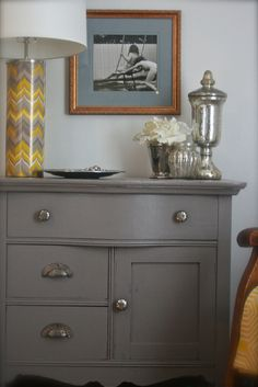 from HouseTalkN: I Painted My Dressers...Don't Tell My Mom! blog. I wonder where she got the chevron lamp???