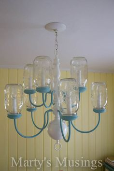 The finished product. Love the blue accents against the yellow wall color. Mason Jar Projects, Mason Jar Crafts, Mason Jar Diy, Diy Projects, Mason Jar Chandelier, Mason Jar Lighting, Diy Kitchen Lighting, Uses For Mason Jars, Kitchen Jars