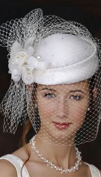 Have you thought about wearing a hat or fascinator instead of a traditional wedding veil? This traditional cloche gets the wedding treatment with white rosettes, and a veil and bow formed from a single oiece of birdcage netting. Bridal Hat, Bridal Headpieces, Wedding Fascinators, Mode Orange, Pillbox Hat, Fancy Hats, Wedding Veils, Birdcage Wedding, Wedding Tiaras