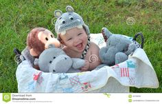 laughter in animals | Laughing Baby Boy In Basket Of Stuffed Animals Stock Photo - Image ...