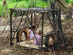 """How to make natural play spaces--use woven willow/wisteria """"tunnels"""" as entrance to play areas; provide buckets and small trowels; use planting and flowers mixed in wiht play area; use tree stumps of differing heights for climbing along; make large size wind chimes at kid height and provide big sticks to gong on them"""