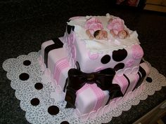 twin girls baby shower cake. I like the cake but not the babies on top haha