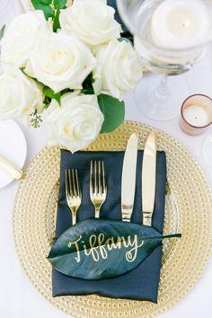 Gold Calligraphy on Magnolia Leaf Name Cards | Gold, Black, White + Green Lowndes Grove Plantation Wedding by Charleston wedding photographer Dana Cubbage Weddings