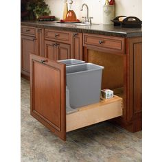 Rev-A-Shelf�30-Quart Plastic Pull Out Trash Can. Think we could build for way less than $300, using existing door, custom built wood tray and organizer with cutouts for cans & garb bags. DEFINITELY cans side by side!!!!! won't have to pull drawer as far out every time. Yes, this is perfect for our island!