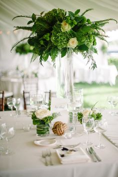 A touch of a nautical vibe - without the navy. See more on SMP: http://www.StyleMePretty.com/midwest-weddings/2014/02/26/green-white-nautical-wedding/ Photography: Melissa Oholendt   Event Planning: Lasting Impressions   Floral Design: Weber Westdale