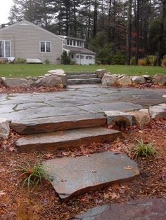 Paver patio with stone slab steps