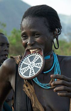 Africa | Smiling Surma woman with lip-plate. Omo Valley, Ethiopia | ©Jean Christophe Huet / JCH Travel
