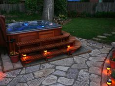 LOVE the stairs around this hot tub with different lighting